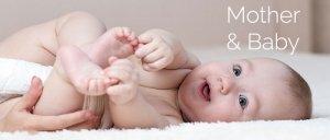 cute baby lying down clutching feet