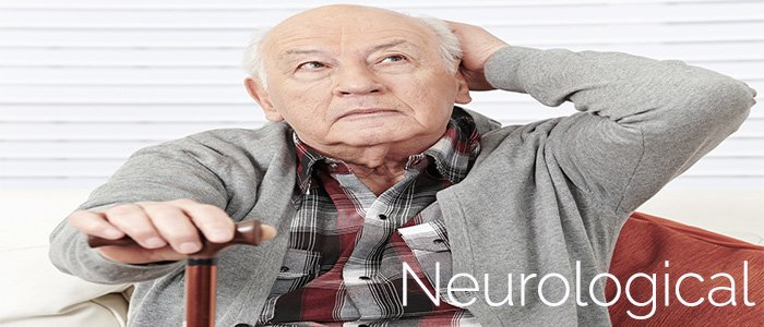 old man sitting with hand on head staring up