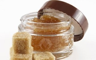 pot of lip scrub with brown sugar cubes