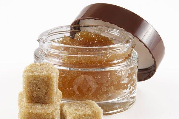 pot of lip scrub with brown sugar cubes
