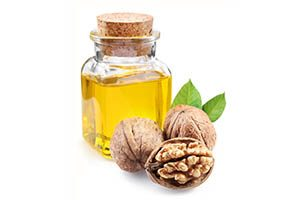 bottle of walnut oil and walnuts
