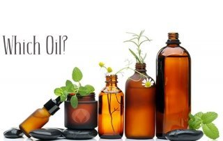 oil bottles with herbs and black stones