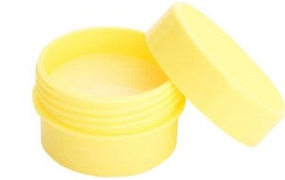 yellow plastic pot with homemade balm