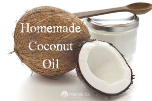 fresh coconut and jar of coconut oil